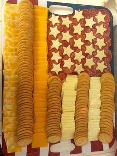 """Flag cheese/meat tray for Memorial Day party. Also great for the 4th of July! I used the Pampered Chef's """"Creative Cutters"""" to make the star shapes. I found the large flag tray at Party City."""