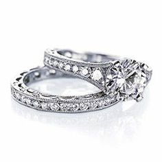 i really love vintage-looking engagement rings and wedding bands
