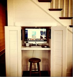 What a great idea! Under the stairs is a hideaway computer station for the family