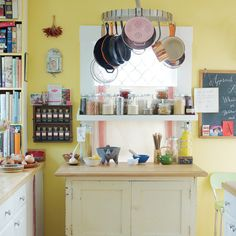When kitchen space is cramped, put a floating shelf in front of a window.