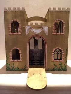 Welcome to my fairytale! What little girl doesnt want to get lost in an enchanting castle? Each castle is a hand painted, one of a kind piece. Perfect size for disney MagiClip dolls. The inside of the castle is wallpapered and hand painted pieces adorn the walls, such as dresses, furniture, chandeliers, etc. This is a wonderful gift for the little girl who loves princesses and fairytales, or as a beautiful decor piece in a little girls room. The castle can be personalized with the childs…