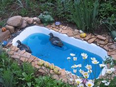 Who thinks of these things!!! cheap yard decorations, ponds and planters made with bathtubs