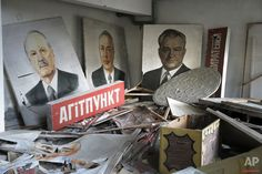 In this photo taken Wednesday, March 23, 2016, portraits of Soviet leaders are covered by radioactive dust in a club in the dead town of Pripyat, near Chernobyl in Ukraine. The portraits were prepared for a May Day rally in Pripyat - the town that housed the Chernobyl nuclear power plant workers - but the residents were evacuated within hours after the radioactive explosion in the fourth reactor on April 26, 1986. (AP Photo/Efrem Lukatsky)