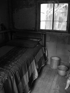 One room cabin in Appalachia. Is that a chamber pot sitting on the floor?