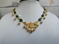 Designed in 14 carat gold. Stunning 14 carat gold necklace with emeralds and pearls. Please contact on Necklace with Lakshmi devi pendant. For direct 03 January 2020 Pearl Necklace Designs, Jewelry Design Earrings, Gold Earrings Designs, Gold Jewellery Design, Beaded Jewelry, Bridal Jewelry, Gold Jewelry Simple, Light Weight Gold Jewellery, Simple Necklace