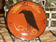 REDWARE PRIMITIVE CROW ON BRANCH PLATE BY CAZAN USA