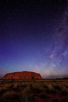 Uluru - A starry night at Uluru (Ayers Rock) in the Northern Territory, Australia - and yes, you really can see the milky way like this. I need this on my bucketlist Oh The Places You'll Go, Places To Travel, Places To Visit, Ayers Rock Australia, Holiday Destinations, Australia Travel, Where To Go, Wonders Of The World, Travel Photos