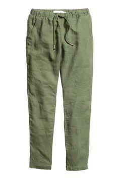 Pantaloni in lino: Pantaloni dritti in tessuto di lino. Elastico e coulisse in vita. Tasche laterali e tasche a filetto dietro.