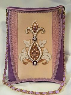 beautiful purse with pomegranate embroidery (embroidery done by Larissa Borodich)! It looks like a stomacher or bodice of an 18th century dress. Lovely colors, beautiful materials (suede, lace, trimmings), expertly handmade by Olesya Bryutova.