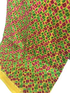 This is an exquisite JustPhulkari saree hand made by our Phulkari Artists. Kota Net base of this saree has been heavily embroidered. Phulkari Saree, Phulkari Embroidery, White Saree, Embroidered Blouse, Outdoor Blanket, Fabric, Handmade, Tejido, White Sari