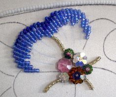 part 2 Threads Across the Web: The beads are worked in long and short stitch, with the first row covering the row of padding. Tambour Beading, Tambour Embroidery, Embroidery Jewelry, Ribbon Embroidery, Beaded Brooch, Beaded Jewelry, Beaded Necklace, Beaded Bracelets, Beading Tutorials