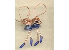 """Cobalt blue semi matte pressed glass bell flowers and daggers  with coiled """"hats"""" and hand forged earwires                            The first comment I got after posting this pic to a jewelry making site was """"I feel happy just looking at these."""""""