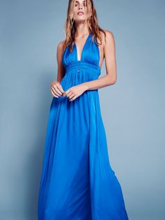 Braided Maxi Dress   Ultra soft and silky maxi dress featuring a braided detail along the halter neckline and a smocked band around the waist for a comfortable fit. Lined at the bodice.