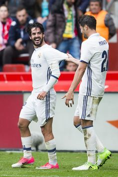 Isco of Real Madrid celebrates with his teammates Alvaro Morata. of Real Madrid after scoring his team's third goal during the La Liga match between Real Sporting de Gijon and Real Madrid at Estadio El Molinon on April 15, 2017 in Gijon, Spain.