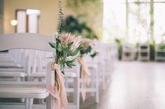 White folding wedding ceremony chairs. #whitewedding #weddingflowers #aislemarkers