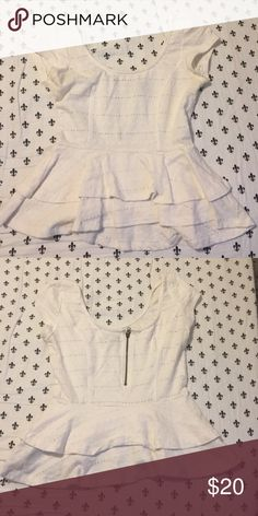 White peplum short sleeve crop top White short sleeve crop. Peplum. Ruffles at the bottom. Horizontal lines with holes as design. 65% cotton 35% polyester zipper half way up the back Lucca Couture Tops Crop Tops