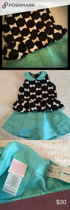 SALE Janie and Jack Tiffany Blue Bow Outfit Janie and Jack 2 piece Tiffany Blue, Black, & White bow outfit. Size 6-12 months. Top has a Peter Pan collar and peplum style waistline and buttons 1/4 way down the neckline. Skirt has adjustable waistline. Worn only twice! Super cute layered with a cardigan or undershirt! Definitely a statement outfit! A must have for any little girl! Preloved but tons of life left! Smoke free and pet free home! Janie and Jack Matching Sets