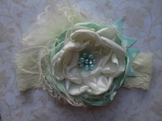 """Gorgeous Mint and Cream colors with tulle and ribbon accents. Approx. 5-6"""" diameter. Each headband is handmade, and unique. No two headbands will be identical, although we get as close as we can! {A C"""