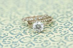 Wilson Diamonds: Ring Style Number R5561E (ring), R5303W (pave band), R5342W (scalloped band)