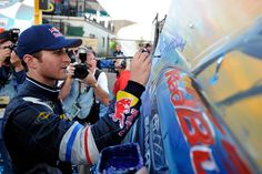 Kasey Kahne signs the painting by Bill Patterson commemorating is fall 2011 NASCAR Sprint Cup Series victory in the Kobalt Tools 500 at Phoenix International Raceway.