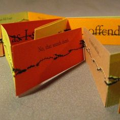 """Artist's book letterpress printed using hand-set type and machine stitched into an accordion format in an edition of 50. Comes nestled in matchbox-style box with a ribbon pull. Box is 3 1/4"""" x 1 1/4"""" x 5/8"""""""