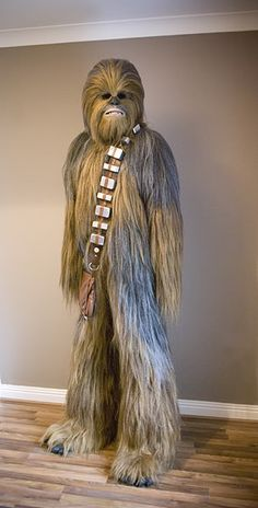 DIY (yes, DIY!) Chewbacca suit...it involves a mesh foundation and requires hand-tying all that fur into it