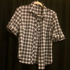 Checkered button up blouse BDG brand from Urban Outfitters. Checkered flannel/blouse perfect with dark skinny jeans or tucked in pencil skirt. Wear it over a cami. 99% polyester/1% spandex. White/black/gray checkers BDG Tops Button Down Shirts