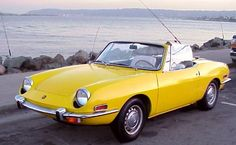 A beautiful scene, Fiat 850 spider by the water. Love it!