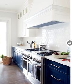 Transitional Kitchen with One-wall, Corian counters, White Subway Tile 3x6 Glossy, Flush, Hardwood floors, Glass panel
