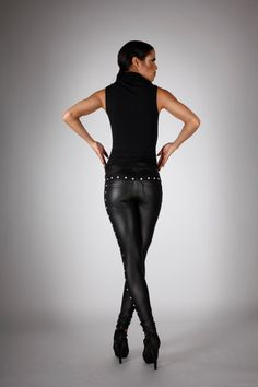 """These sexy-as-hell pair of leggings are made from high quality spandex featuring 4-way stretch. Low-waisted with a waistband of 1,5""""/3,8cm. Plain front and LQ signature V-cut back pockets. Silver studs embellishment along the outside of the legs and in the back above the pockets puts a bang-up twist on the classic """"Jeans Back Leggings"""". • Color: Matte Black • Material: 80% spandex, 20% nylon • The Model is wearing a size: S • Unisex, works on both men & women Available in size XS-XL. Can…"""