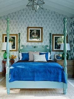 Wallpapered accent wall, robin's egg blue painted bed, geometric light fixture.