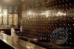 SuperStock - Druggist in an old Chinese pharmacy with an antique apothecary cabinet, Tunxi, Huangshan Shi, Anhui Province, China, Asia