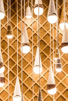 Dangling light fixtures created by the artist Alex Garnett in a room of the museum dedicated to ice cream cones. (Photo: George Etheredge/The New York Times)