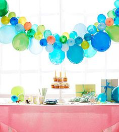 Birthday Party Balloons: Inflate, knot, and then clip regular-size and 5-inch balloons to a ribbon for a festive focal point. Plastic Balloon Clips, $4 for 144 at partycity.com