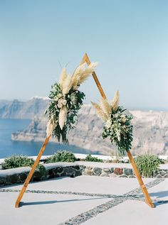 Wedding Flower Arrangements Triangle arch with pampas grass and king proteas- Modern wedding in Greece - Bohemian and Modern, Greek wedding in Santorini, Greece Grecian Wedding, Floral Wedding, Wedding Flowers, Boho Wedding, Wedding Bouquet, Purple Wedding, Wedding Card, Trendy Wedding, Summer Wedding