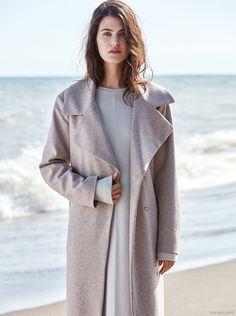 Kasia Szymanska Pose on the beach for a fall fashion Photoshoot