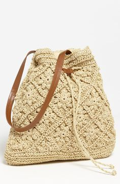 Free shipping and returns on Straw Studios Crochet Tote at Nordstrom.com. Floral designs add texture to a crocheted straw tote topped with a single handle.
