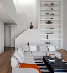 To the side of this living room, is a custom designed bookshelf, that runs the height of the stairs.