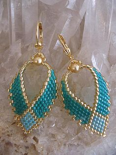 "These pretty Russian leaf earrings are handmade with transparent teal, light aqua rainbow, & golden delica seed beads with gold Swarovski glass pearls. They measure just under 2"" long including the leverback earwire. The leaf itself measures just under 1-1/2"" long, & 7/8"" wide."