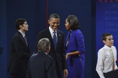 54 10/3/12 Moderator Jim Lehrer shakes hands with President Barack Obama, First Lady Michelle Obama looks on after the presidential debate Wednesday, October 3, 2012 at the University of Denver. John Leyba, The Denver Post