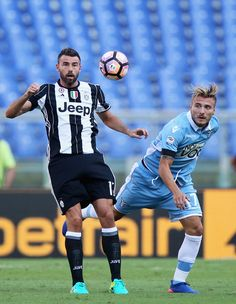 Andrea Barzagli (L) of  Juventus FC competes for the ball with Ciro Immobile of…
