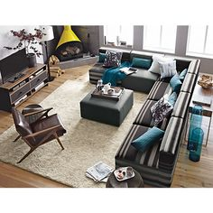 Savino Sectional Sofa, Cavett Leather Chair, Aerie Medium Accent Table, Notti Floor Lamp, Parker Rug I Crate and Barrel