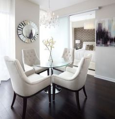 Love everything about this dining room: chairs, floors, wall color, mirror, table, art.