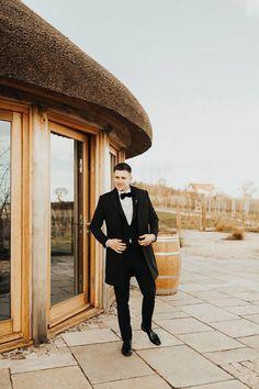 Groom in Classic Black Tuxedo for Micro Wedding   By Paige Grace Photography   Micro Wedding   Intimate Wedding   Pink Wedding Dress   Wedding Flowers   Contemporary Wedding   Groom Wedding Suit