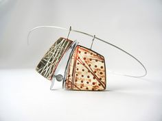 """Read between the Lines"" - polymer clay, metal and glass pendant by Sonya Girodon."