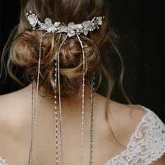 A veil of gems and rhinestones falling from flowers tucked into your hair will have every head turning to look at you. | Falling Stars Hair Chain Comb via @andprettythings
