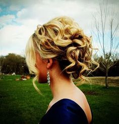 Curly updo. I like that is pinned out of   the way... Yet has body, and length by leaving a few strands   down!