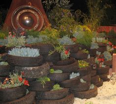 Used tires - a garden wall - could use tiered as a walkway/stairs to the river