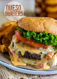 Queso Burgers at http://therecipecritic.com  These amazing burgers are topped with delicious cheesy queso and will blow your mind!