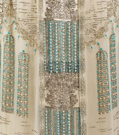 """Evening Dress (Detail), 1909-11 - Incredible beadwork embroidery, """"indicative of French couture craftsmanship. The juxtaposition of three-dimensional and trompe l'oeil tassels is stylish and witty, and highlights the level of planning and care taken in the design of couture garments."""" http://fashioninhistory.tumblr.com"""